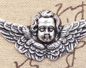 Cabeza de Angel entre Alas
